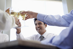 Businessman With Colleagues Toasting Wineglasses stock photos