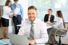 Businessman with colleagues Stock Images