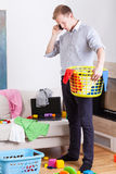 Businessman collecting dirty clothes Royalty Free Stock Image