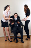 Businessman with collegues in armchair Stock Images