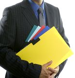 Businessman and color folders over white Royalty Free Stock Photos