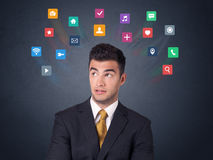 Businessman with colorful apps Royalty Free Stock Images