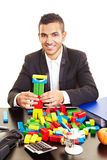 Businessman with colorful bricks Stock Photography