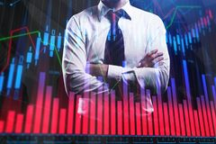 Businessman with colorful forex chart. Finance and fund management concept. Double exposure Stock Images