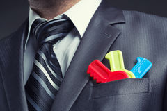 Businessman with colorful toy keys Royalty Free Stock Photo