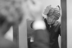 Businessman combing his hair Royalty Free Stock Photo