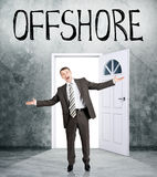 Businessman comes out of room with word offshore Stock Photography