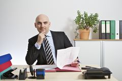 Businessman comes thoughtfully to a decision. Royalty Free Stock Photos