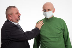 Businessman comforting young man suffering from cancer Royalty Free Stock Photo