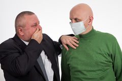 Businessman comforting young man suffering from cancer Stock Photos