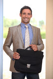 Businessman coming through doorway Royalty Free Stock Images