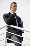 Businessman coming down the stairs Royalty Free Stock Photography