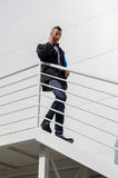 Businessman coming down the stairs Royalty Free Stock Images