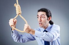 Businessman committing suicide Stock Photography