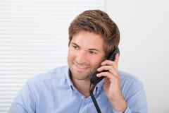 Businessman Communicating On Landline Phone Royalty Free Stock Photography