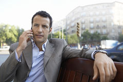 Businessman Communicating On Mobile Phone Outdoors Stock Photography