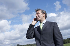Businessman Communicating On Mobile Phone Royalty Free Stock Photo