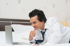 Online. Businessman communicating by skype in a hotel Royalty Free Stock Images