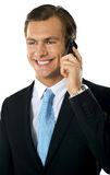 Businessman communicating via cellphone Royalty Free Stock Photography