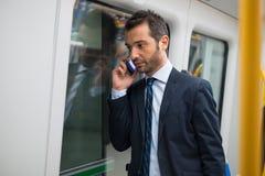 Businessman commuter traveling on the metro underground Stock Photography