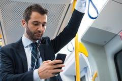 Businessman commuter traveling on the metro underground Royalty Free Stock Image