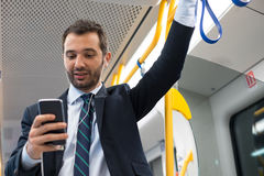 Businessman commuter traveling on the metro underground Royalty Free Stock Images