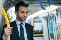 Businessman commuter traveling on the metro underground Stock Photos