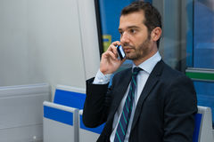 Businessman commuter traveling on the metro underground Stock Images
