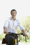 Businessman Commuting On Bicycle Stock Photography
