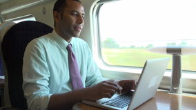 Businessman Commuting To Work On Train And Using Laptop stock video