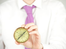 Businessman with compass Royalty Free Stock Image