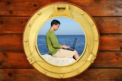 Businessman with computer, boat window view Royalty Free Stock Photos