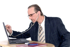 Businessman, computer doctor. Workaholic, businessman, investigating computer doctor. Business, corporate, security concept royalty free stock photography