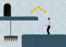 Businessman in Computer Game Level with coins and trap stock images