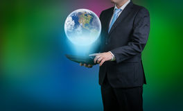 Businessman computer and a globe. Businessman with computer and a world hologramm Royalty Free Stock Photo