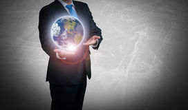 Businessman computer and a globe Stock Images