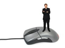 Businessman on computer mouse. Isolated on white background stock images