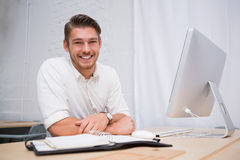 Businessman with computer at office desk Royalty Free Stock Image