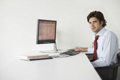Businessman With Computer At Office Desk Royalty Free Stock Photos