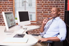 Businessman with computer at office desk Stock Image
