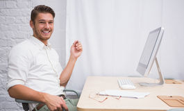 Businessman with computer at office desk Stock Photography