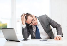 Businessman with computer, papers and calculator Royalty Free Stock Photography