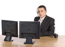 Businessman at he computer's screens Stock Image