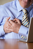 Businessman At Computer Suffering Heart Attack Stock Photos