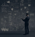Businessman with computer tablet.  Schematic background. Busines. S and office, concept Royalty Free Stock Images