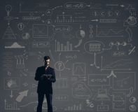 Businessman with computer tablet.  Schematic background. Busines. S and office, concept Royalty Free Stock Photos