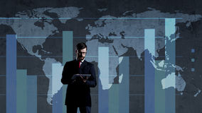 Businessman with computer tablet standing over diagram. World ma. P background. Business, globalization, capitalism concept Stock Photo