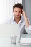 Businessman concentrating on computer work Royalty Free Stock Photo