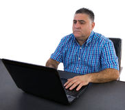 Businessman concentrating on his work. On the laptop Royalty Free Stock Photography