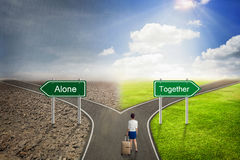 Businessman concept, Alone or Together road to the correct way. Stock Photos
